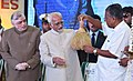 M. Hamid Ansari being presented a memento by the Chief Minister of Kerala, Shri Pinarayi Vijayan, at the inauguration of the 2nd stage of the total e-Literacy and commencement of the Digital Libraries programmes, in Kerala.jpg
