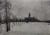 Main Building and Bowman Field in winter (Taps 1909).png