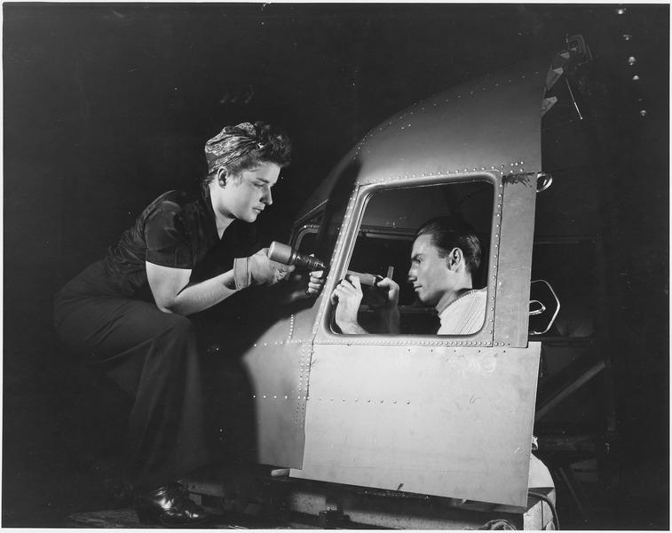 Man and a woman making an efficient operating on riveting at the Long Beach, Calif., plant of Douglas Aircraft Company. - NARA - 195489