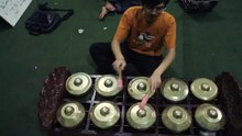 File:Man demonstrating arrangement of sundanese gamelan bonang gong in pairs of ascending notes.ogv
