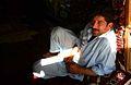 Man in carpet store, Mazar-e Sharif, June 16, 2005.jpg