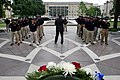 Man speaks to law enforcement explorers at National Law Enforcement Officers Memorial with wreath.jpg