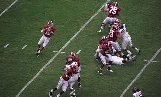 AJ McCarron - McCarron (10) drops back to attempt a pass against Kent State