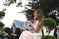 Melania Trump presents a book.jpg