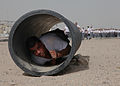 Members of Iraqi Police and Border Patrol crawl through a pipe while running an obstacle course at the Police Academy in Basrah, Iraq, May 4, 2011 110504-A-YD132-074.jpg
