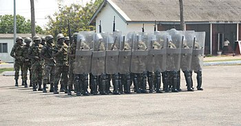 Members of the Ghana Army 2nd Engineer Battalion assemble in a riot control formation during nonlethal training June 26, 2013, in Accra, Ghana, as part of exercise Western Accord 2013 130626-A-ZZ999-003.jpg