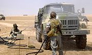 Members of the Ukrainian Army's 19th CBRN-Battalion maintaining decontamination skills in Support of Operation Iraqi Freedom at Camp Arifjan, in KUWAIT on August 3rd 2003