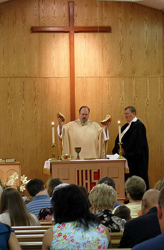 "Mainline Protestant - A minister presides over Communion Sunday service in a United Methodist Church, a typical mainline Protestant denomination and one of the ""Seven Sisters of American Protestantism""."