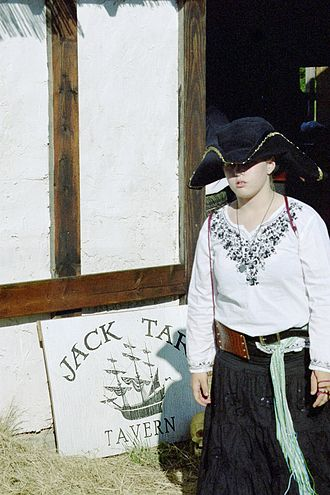 Middlefaire - A girl exits Jack Tar Tavern at the first Texas Pirate Festival at Middlefaire.  Binky the WonderSkull can be seen in the shadows. (2010)
