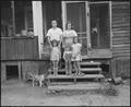 Mr. and Mrs. James Wheeler and their three children. They have lived in the four room house, the porch of which they... - NARA - 541118.tif