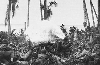Battle of Munda Point - U.S. Army soldiers attack Japanese fortifications with flamethrowers on or around 1 August 1943 during the battle for the airfield.