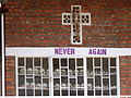 Never Again - With Display of Skulls of Victims - Courtyard of Genocide Memorial Church - Karongi-Kibuye - Western Rwanda - 01.jpg