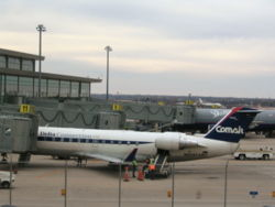 A Delta Airlines Comair parked at Will Rogers World Airport (with the old Comair logo on tail)
