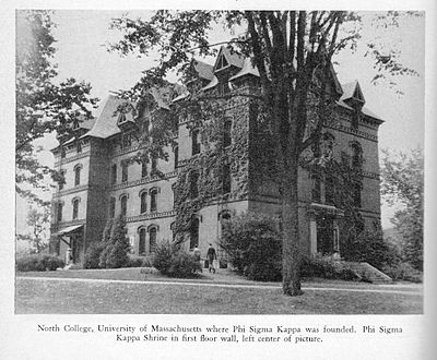 "Old North Hall, site of ΦΣΚ's founding in 1873, at the University of Massachusetts Amherst. ""The Shrine,"" a memorial to the Founders, is visible at the left of the front door.  Brooks was present for its dedication."