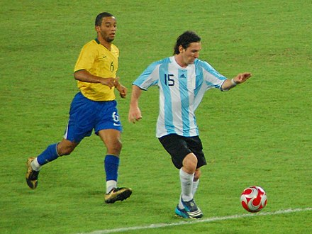 Messi evades Brazil's Marcelo in the semi-final of the 2008 Summer Olympics. Olymics final 2008.jpg