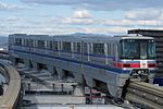 Osaka Monorail 2111 at Sawaragi Station.JPG