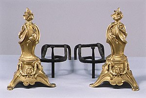 Andiron - French, late 18th century. Gilt-bronze fronts, wrought iron behind