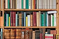 Part of a bookshelf containing books by ancient philosophers (Loxia 85mm F2.4).jpg
