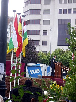 Flag of La Rioja - Flags of La Rioja and of Spain, during an official event featuring the community's president.