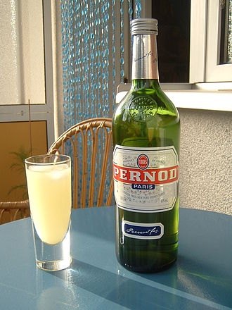 Pernod Ricard - Pernod in a glass with water and ice