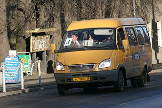 """Marshrutka - A yellow GAZ-3221 GAZelle marshrutka on duty in Petrozavodsk, Russia. Note the passengers occupying seats right next to the driver-cabin design typical for trucks which """"GAZelle"""" family is an example."""