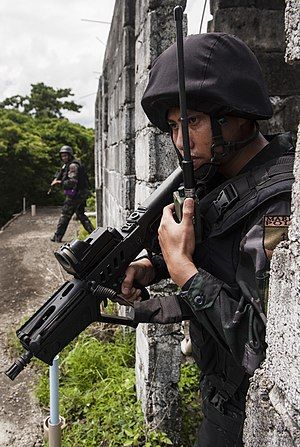 Philippine National Police Maritime Group - Philippine National Police (PNP) Maritime Group member communicates with other PNP forces during a direct action training scenario as part of the Joint Interagency Task Force (JIATF) West exercise Aug. 6, 2014, in Puerto Princesa, Philippines