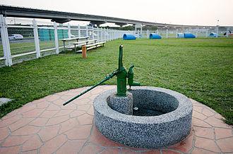 Water supply and sanitation in Taiwan - Piston water pump at Yingfeng Riverside Park in Taipei.