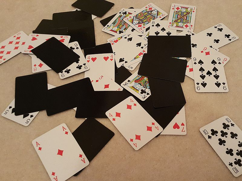 File:Playing cards spread on floor.jpg