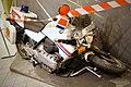 Police of Norway. Crashed wrecked BMW motorbike 1997 on exhibition. Coat of arms Emblem. Politiets eskorte og ryddetjeneste 1997. BMW Motorsykkel. Justismuseet, Trondheim 2019 DSC06915.jpg
