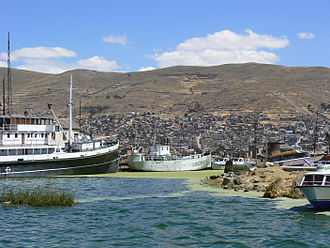 SS Ollanta - When the Ollanta was completed in 1931, she was the largest ship on Lake Titicaca. This view of the port of Puno in 2006 contrasts the size of Ollanta (left) with that of Lake Titicaca's first steamship, BAP Puno (centre, formerly SS Yapura)