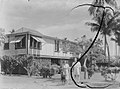 Portrait of two women in front of house (AM 88235-1).jpg