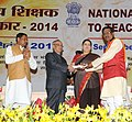 Pranab Mukherjee presenting the National Award for Teachers-2014 to Shri Ashok Kumar Tiwari, Madhya Pradesh, on the occasion of the 'Teachers Day', in New Delhi. The Union Minister for Human Resource Development.jpg