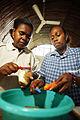 Preparing nutritious food at Wan Smolbag. Vanuatu 2007. Photo- Rob Maccoll - AusAID (10714598366).jpg