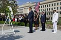 President Barack Obama lays a wreath at the Pentagon Memorial with First Lady Michelle Obama and others.jpg