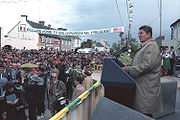 United States President Ronald Reagan speaking to large crowd in his ancestral home in Ballyporeen, Ireland in 1984.