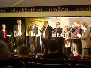European Parliament election, 2014 (Finland) - Hustings panel with Finnish political party chairpersons and top candidates on Europe Day 2014. Left to right: Sari Essayah, Mikael Pentikäinen, Jyrki Katainen, Timo Soini, Carl Haglund, Liisa Jaakonsaari, Paavo Arhinmäki, Ville Niinistö.
