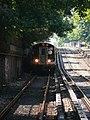 Q train arriving at Newkirk Ave station 2.jpg