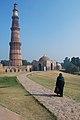 Qutub Minar with lady.jpg