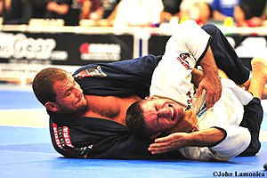 "Brazilian jiu-jitsu gi - BJJ blackbelt Roberto ""Cyborg"" Abreu chokes his opponent using the gi at the 2009 Pan-Am Championship."