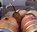 Racking wine between barrels.JPG