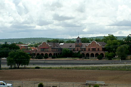 Historic Castaneda railway hotel as seen from I-25 Rail Station in Las Vegas, New Mexico.JPG