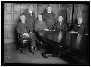 William Russell Willcox - Railway Wage Commission with a seated James Harry Covington, Franklin Knight Lane, Charles Caldwell McChord, and William Russell Willcox. Standing are William A. Ryan and Frederick William Lehmann.