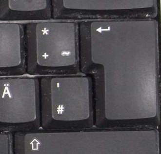ISO/IEC 9995 - Return key on a German T1 keyboard, spanning over two rows