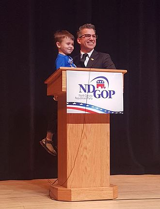 Rick Becker - Rick Becker on stage with his grandson at the March 3rd, 2016 gubernatorial debate in Bismarck, North Dakota.
