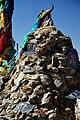 Rock cairn and prayer flags along the Friendship Highway, Tibet on 19 May 2014.jpg