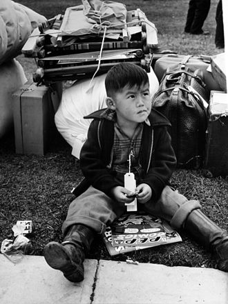 "Internment of Japanese Americans - A child is ""Tagged for evacuation"", Salinas, California, May 1942. Photo by Russell Lee"