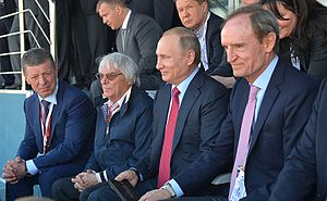2016 Russian Grand Prix - Bernie Ecclestone (second from the left) and Vladimir Putin (second from the right) in the grandstands during the race