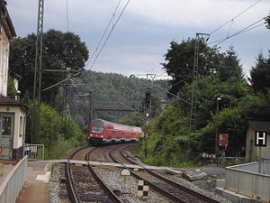 Double-decker train approaching the spa town of Rathen