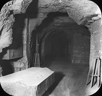 Saqqara - Lantern Slide Collection: Views, Objects: Egypt. - Apis Tombs, passage showing Sarcophagi Recess, Sakkara., n.d., Brooklyn Museum Archives