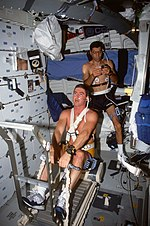 STS-44 crewmembers exercise using treadmill rowing device on OV-104's middeck.jpg